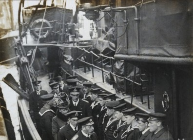 King George V and Queen Mary, with Lieutenant Colonel J H Pitts, inspect a Navy trawler used for minesweeping. (c) Hull Museums.