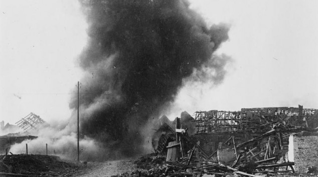 A British 8-inch shell exploding in Oppy. (c) IWM (Q 57547).