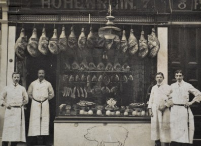 Charles Hohenrein standing in the doorway of his pork butcher's shop at 7 Waterworks Street, Hull. (c) Hull Museums.
